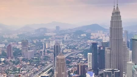 határkő : Cloudscape panning view city panorama with Petronas Twin Towers at KLCC City Center. The most popular tourist destination in Malaysian capital. Time lapse Stock mozgókép
