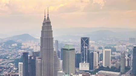 панорамирования : Cloudscape panning view city panorama with Petronas Twin Towers at KLCC City Center. The most popular tourist destination in Malaysian capital. Time lapse Стоковые видеозаписи