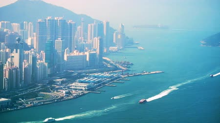 komerční : Aerial view of Hong Kong Island. Busy Financial District at Victoria Harbor with port and moving boats