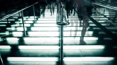 hong kong foot : Time lapse people silhouettes moving at illuminated stairway at modern shopping mall, Hong Kong. High contrast, blur effect, unrecognizable people