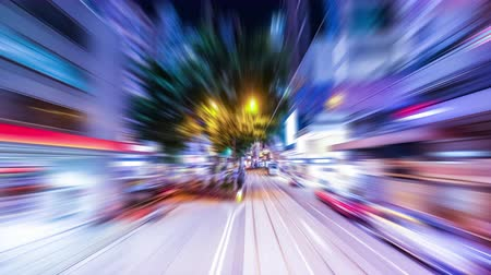 運輸 : Time lapse moving through modern night city street with skyscrapers. Hong Kong. Abstract cityscape traffic background with motion blur 影像素材