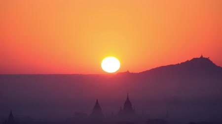 mianmar : Amazing sunrise over ancient Buddhist Temple silhouettes at Bagan. Myanmar Burma travel landscape and destinations