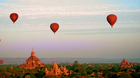 mianmar : Hot air balloons flying at sunrise over ancient Buddhist Temples at Bagan. Myanmar Burma travel landscape and destinations