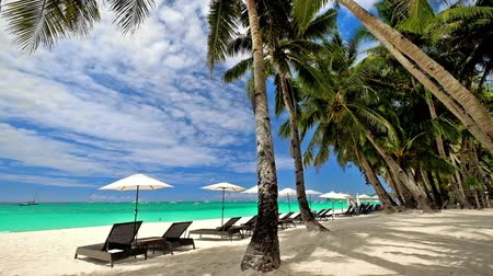 holiday villa : Amazing tropical beach landscape with palm trees, umbrellas and chairs for relaxation on white sand. Boracay island, Philippines summer travel and vacation