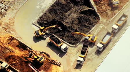 escavador : Excavators and tipper tracks working at construction. Hong Kong. Video form aerial view point