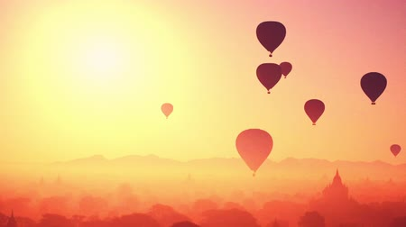 morning : Hot air balloons flying at sunrise over ancient Buddhist Temples at Bagan. Myanmar Burma travel landscape and destinations