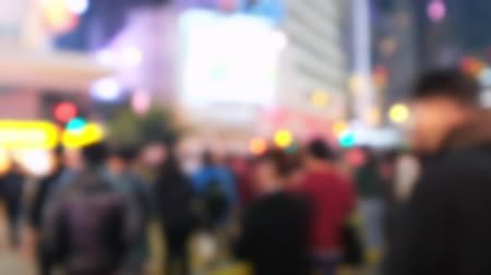 életmód : Blurred video of crowded city street with people moving at crossroad. Hong Kong night life