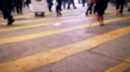 hong kong foot : Blurred fast speed video of people moving at crossroad in crowded evening city street. Hong Kong night life Stock Footage