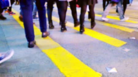hong kong foot : Blurred slow motion video of people moving at crossroad in crowded city street. Hong Kong abstract urban background Stock Footage