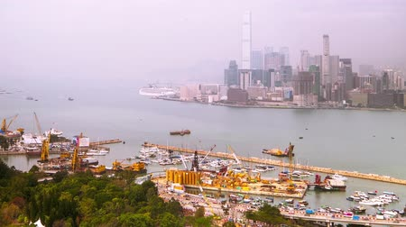 Time lapse aerial panorama view of Hong Kong Island with cargo port terminal and skyscrapers. Modern financial and cultural asian city at Victoria Harbor