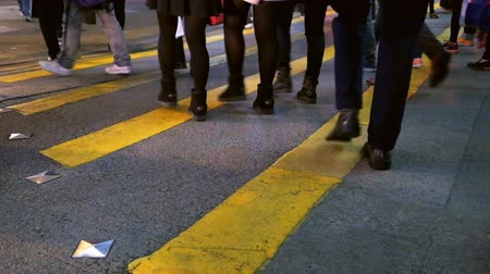 hong kong foot : HONG KONG - JAN 16, 2015: Fast speed video of people moving at crossroad in crowded city street