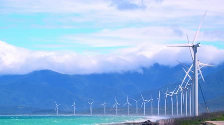 natural resource : Wind turbine rotating over blue sky generating green energy. Industrial eco technology. Alternative renewable energy production in Philippines