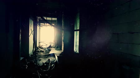 abandoned city : Gloomy corridor with damaged wiring hanging on walls and sticking out floor in abandoned building. Creepy, unfriendly and scary place. Post-apocalypse and nuclear fallout concept. Live camera view.