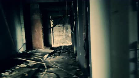 eixo : Handheld camera brokenly moves through hall of abandoned factory. Industrial building after technological disaster concept. Horror quest game scene. First-person perspective, shaky live cam view.