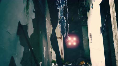 abandoned city : Camera moves through gloomy corridor of dilapidated building towards bright flashing light source at the end. Alien invasion movie scene concept. Shaky live cam view, first-person perspective.
