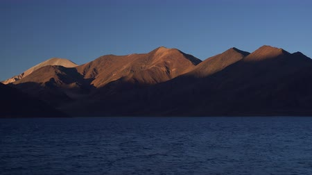 tibet : Spectacular landscape with Pangong Tso lake and gorgeous Himalayan mountain range illuminated by soft light of setting sun. Picturesque sunset or beautiful sundown. Ladakh, India. Panoramic view.