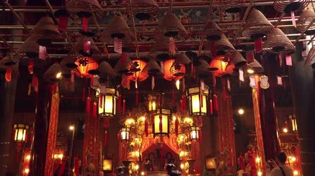 smolder : HONG KONG - OCT 31, 2017: Beautiful interior of Man Mo Taoist Temple decorated with handing lanterns and smoldering incense burners. Gorgeous sanctuary, traditional religious place of worship.