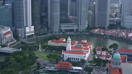 SINGAPORE - OCT 19, 2017: Central area of Singapore with Fullerton hotel, Victoria Theatre and Concert Hall and other historical buildings against river and Marina Bay Financial Centre on background. Стоковые видеозаписи