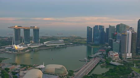 SINGAPORE - OCT 19, 2017: Picturesque panoramic view of Marina Bay Sands district and central city area with modern buildings of unusual architecture and sea. Beautiful urban landscape or cityscape.