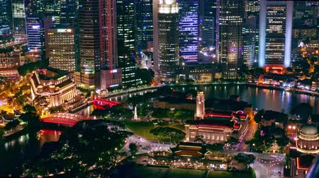 bird's eye view : SINGAPORE - OCT 19, 2017: Fantastic night view of Singapore city center with beautiful historical buildings illuminated by colorful lights against river and Marina Bay Financial Centre on background.