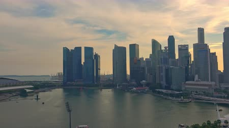 SINGAPORE - OCT 20, 2017: Panoramic view of Marina Bay Sands district in evening. Gorgeous buildings of unusual modern architecture and sea against beautiful cloudy sunset sky on background.