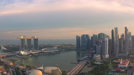 SINGAPORE - OCT 19, 2017: Amazing evening view of Marina Bay at sunset. Fantastic skyscrapers and buildings of modern architecture against setting sun and picturesque sky on background