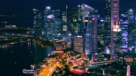 lew : SINGAPORE - OCT 19, 2017: Picturesque panoramic view of Marina Bay Sands district and central city area with modern buildings of unusual architecture and sea. Beautiful urban landscape or cityscape.