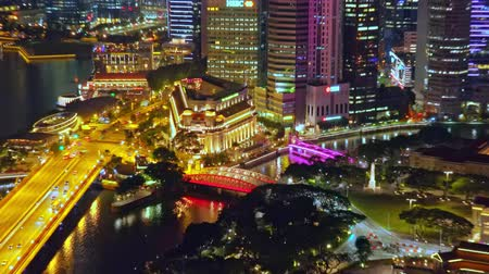 SINGAPORE - OCT 19, 2017: Picturesque panoramic view of Marina Bay Sands district and central city area with modern buildings of unusual architecture and sea. Beautiful urban cityscape. Zoom out