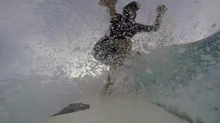 surfovat : Slow motion point of view surfer catching wave and wiping out on take off
