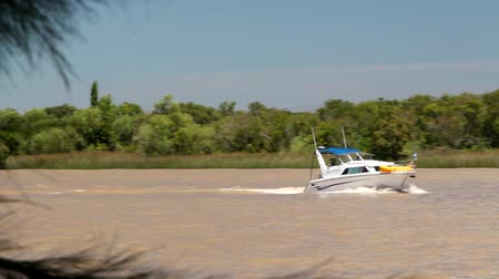 speedboats : White yacht navigates the river