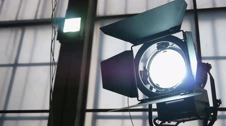 filmagens : Adjustment Of Lighting Device During Filming. Turning On The Device. Close Up.