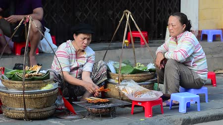 etnisite : Ho Chi Minh City Vietnam Feb 22 2015: Street food vendor sitting on sidewalk Preparing food in Ho Chi Minh City Saigon South Vietnam.