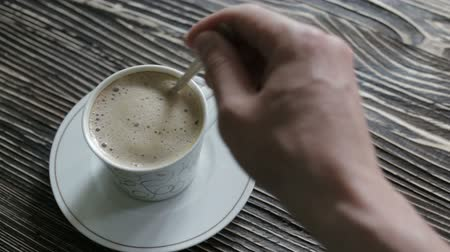 latte macchiato : A cup of cappuccino with foam is on the table