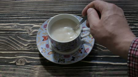 hot beverage : Hot tea with milk on the table Stock Footage