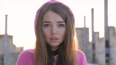 it's cool : Frozen girl in a pink sweater in the ruins. slow motion