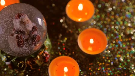 unicef : Christmas souvenir on a background of lighted candles and glitter