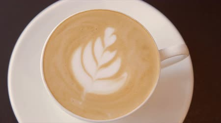 frothy : Coffee with whipped cream in a white cup Stock Footage