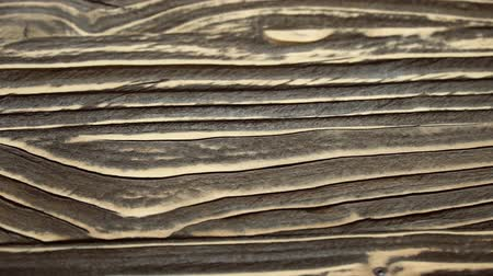 wall building feature : A sliding footage of a beautiful wooden surface texture. May be used for background. Stock Footage