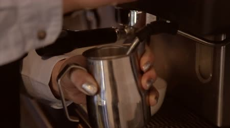 frothy : Barista whipping milk in a jar on a professional coffee machine Stock Footage