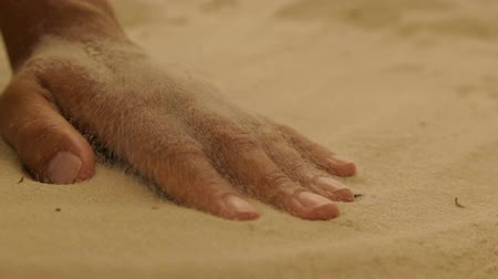 clasped : Dry sea sand on a womans hand