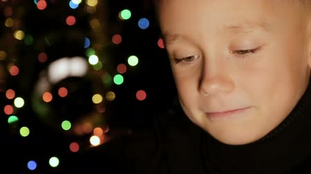 focus on foreground : Portrait of a child in the background of Christmas lights