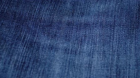 denim : Blue denim jeans texture. Jeans background. Top view. Stock Footage