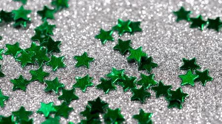 軽量 : Sparkling glitter in the shape of a star. Close-up on a silver background