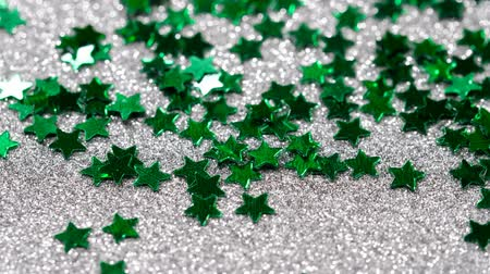 lightweight : Sparkling glitter in the shape of a star. Close-up on a silver background