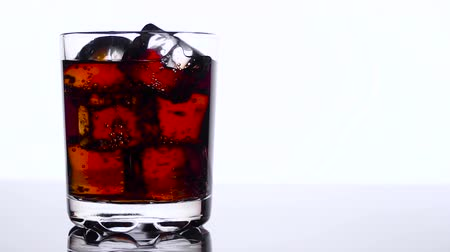 pálinka : Whiskey in a glass with ice cubes