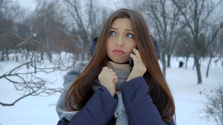 She warms his hands at winter standing in the snow. Full hd video