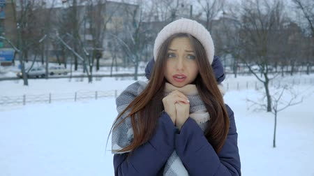 иней : She warms his hands at winter standing in the snow. Full hd video
