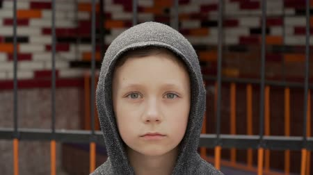 Portrait of a boy near the metal fence Стоковые видеозаписи