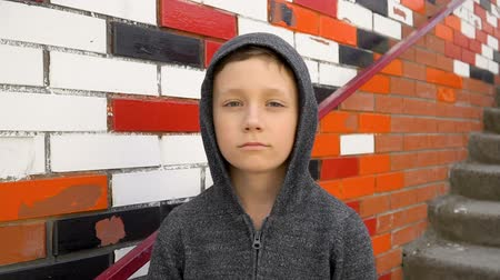 Portrait of a boy against a wall