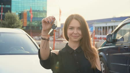 modo : Happy girl with key in hand from new car